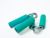 Old Fitness hand grips. A pair of old, unused and now slightly rusty exercise hand grips Stock Photos
