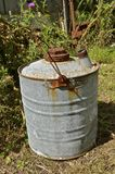 Old five gallon oil can. An old rusty five gallon gas and oil used for transporting gas and oil royalty free stock photo