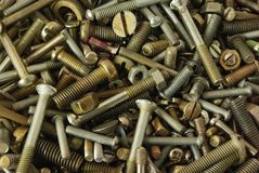 Old fixture as background. Old bolts,screws,nuts and pucks as background Stock Images