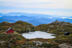 Сold fjords tops. Picturesque Ulriken mountain, Bergen, Norway Royalty Free Stock Image