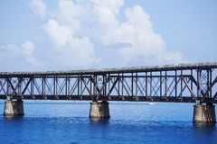 The old Flagler train bridge on s sunny day in the Keys with white puffy clouds. Royalty Free Stock Photo