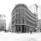 Old flat iron building. In downtown boston massachusetts with pedestrians on a winters morning with faces blurred shot to look old fashiioned, vintage Royalty Free Stock Photography
