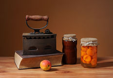 Old flatiron and apricot jam Royalty Free Stock Photos