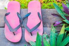 Old flip flop in wooden floor Royalty Free Stock Photos