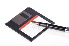 Old fllopy floppy disk and fountain pen Royalty Free Stock Image