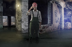 Old flooded building. Construction work inside the old building flooded knee-deep in water stock images