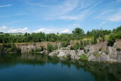 Old flooded quarry Stock Photos