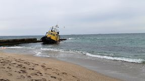Old flooded towing ship. Shipwreck. Sunken towing ship Odessa Ukraine royalty free stock photo