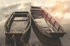 Old flooded wooden boats on river Stock Images