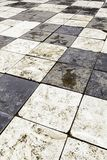 Old floor with chess squares. Decoration detail in black and white Royalty Free Stock Image