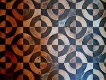 Old floor. Different shape and color scuffed tiles background stock photography