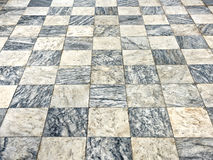 Old floor of light and dark marble squares Stock Photos