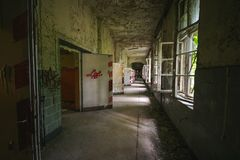 An old floor with open doors and windows in an abandoned places royalty free stock photos