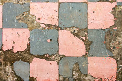 Old Floor Tiles. A Grunge Background with Old Broken Floor Tiles Royalty Free Stock Images