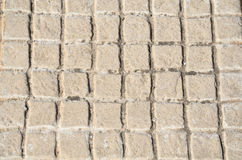 Old floor tiles small beige stone Royalty Free Stock Photography