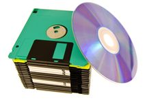 Old floppy and disk. Media technology progress Royalty Free Stock Photo