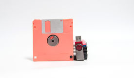 Old floppy disk and flash drive put on white background. Royalty Free Stock Images