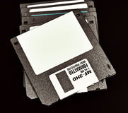 Old floppy disks on a black background Stock Photography