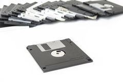 Old floppy disks for computer on the white. Royalty Free Stock Image