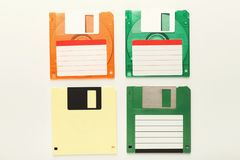 Retro floppy disks isolated on white background. Old floppy disks isolated on white background. Top view of magnetic retro storage devices, cutout of colorful Royalty Free Stock Image