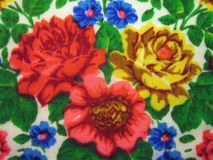 Old floral fabric with colorful flowers. Old beautiful fabric with red , yellow and blue flowers Stock Images