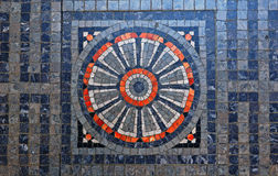 Old floral mosaic. Old  mosaic with the shape of a flower Stock Images