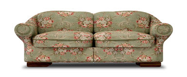 Old Floral Sofa Front. An old vintage sofa with a green and red floral fabric on an  background Stock Photography