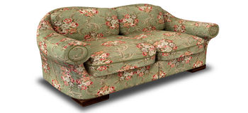 Old Floral Sofa Perspective. An old vintage sofa with a green and red floral fabric on an  background Stock Images