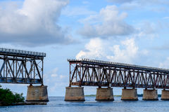 The old Florida East Coast Railway Pratt Truss bridge spanning b. Etween Bahia Honda Key and the Spanish Harbor Key with the old two lane highway US1 stock images