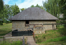 Old Flour Mill - Suceava Village Museum. This traditional Romanian flour mill is called the Manastirea Humorului Mill, being originally located in the community Stock Image