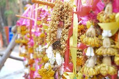 Old flower garland hang on the rail Royalty Free Stock Photo