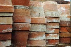 Old Flower Pots. Stacks of old terra cotta flower pots in a gardening shed Royalty Free Stock Photography