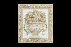 Old flower vase carve. Old flower vase sculpture on black background stock images
