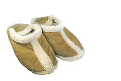 Old fluffy slippers. Old worn soft fleecy slippers Stock Photo
