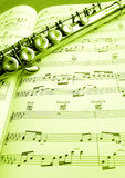 Old Flute And Music Score Stock Image