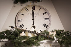 Old flute near a New Year clock. Christmas concept Stock Photo
