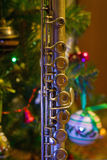 Old flute near a New Year tree. Christmas concept Royalty Free Stock Image