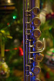 Old flute near a New Year tree. Christmas concept Royalty Free Stock Photos