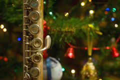 Old flute near a New Year tree. Christmas concept Stock Photos
