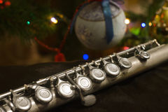 Old flute near a New Year tree. Christmas concept Stock Images