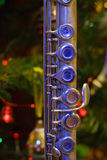 Old flute near a New Year tree Royalty Free Stock Images
