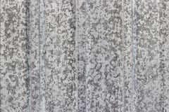 Old  fluted or corrugated metal sheet. Old  fluted or corrugated metal galvanized sheet of steel color with an abstract pattern of gray spots. texture Stock Photography
