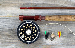 Old fly reel and rod on rustic wood Stock Photos