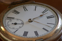 Old fobwatch. An old brass Fobwatch Royalty Free Stock Photography