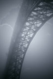Old foggy iron bridge Stock Photo