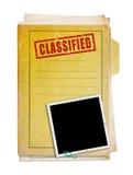 Old folder with top secret stamp. Old folder with top secret stamp and photo, clipping path Stock Photography