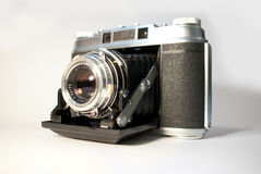 Old folding camera. An old folding camera isolated on white Stock Images