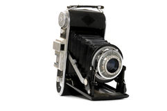 Old folding camera. On a white background Royalty Free Stock Photography