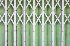 Old folding metal(Steel Rolling Shutter) door gate - Vintage sty Royalty Free Stock Images