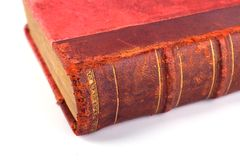 Old Folio. In dark red cover on white background. Book with ancient knowledge Stock Images